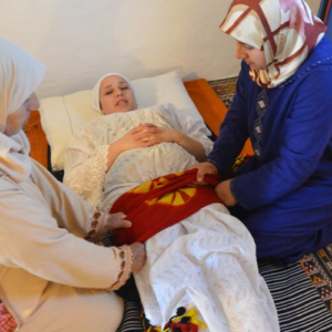 moroccan closing the bones ceremony on a woman by traditional midwives